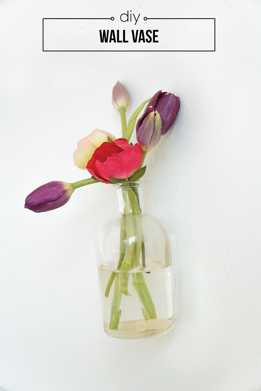 Hang flowers on vertical spaces fast, easily, and non-permanently with this 5 minute DIY wall vase. Click for the details!