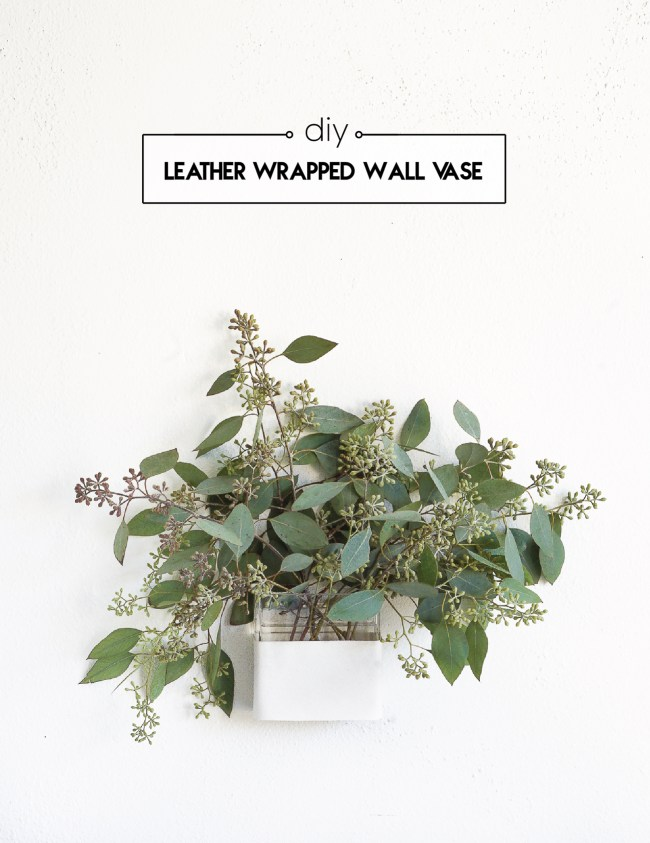 Move the flowers from the table to the wall with this space-saving leather wrapped wall vase. Click for the full tutorial!