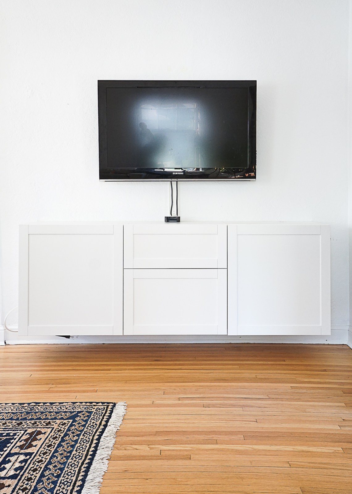 DIY a built-in floating media cabinet for storing tv accessories, kids toys, and beyond. Click for the complete tutorial!