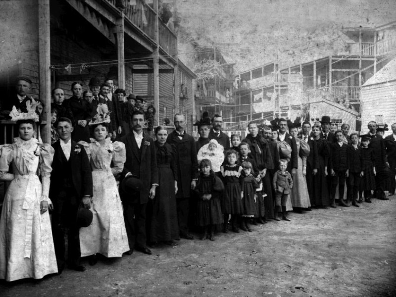 This is an historical photo of a large wedding party in Lewiston, Maine in 1897 from the Maine Memory Network..