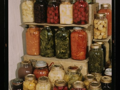 A color photo of a display of home canned food