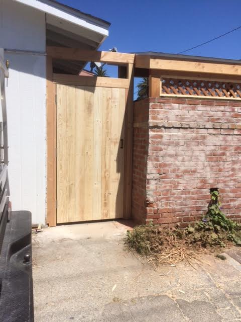 wooden gate / wooden door by Francos Remodeling Carpenter Manhattan Beach