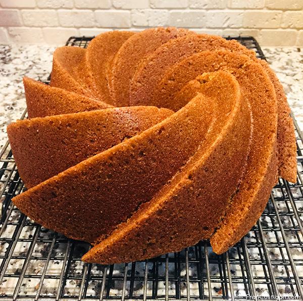 Orange Almond Bundt Cake on cooling rack