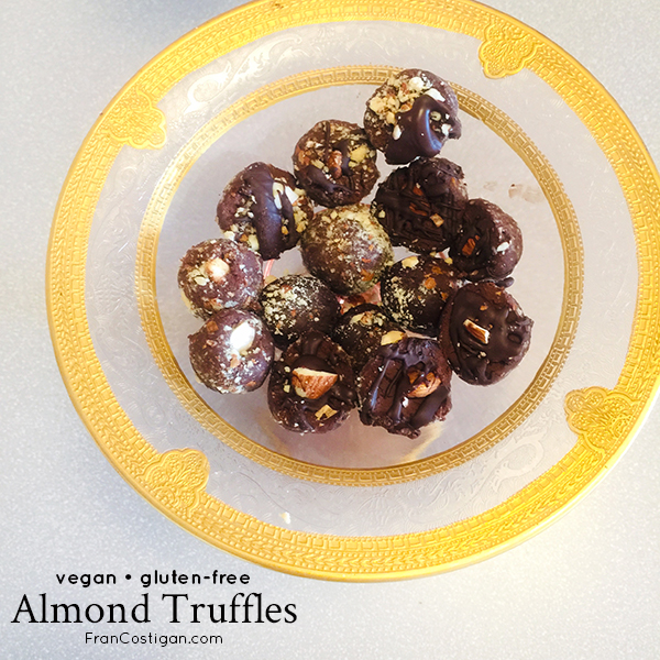 Finished almond truffles on plate with text overlay