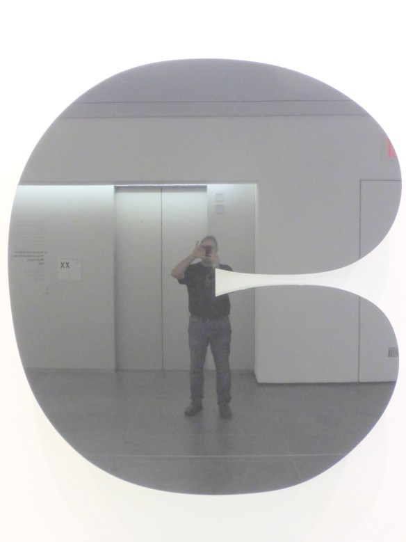 Jeremy's reflection in a piece of mirrored artwork