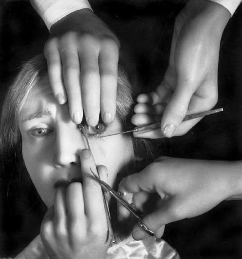 Here you go, have some nightmares. (Photograph by Herbert List, 'Operation des Schielens', 1944/46)