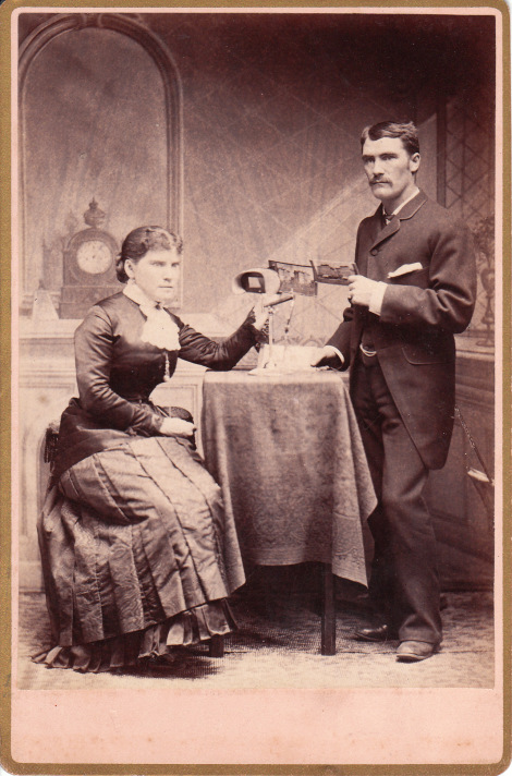 A cabinet card depicting a couple with their stereoscope.