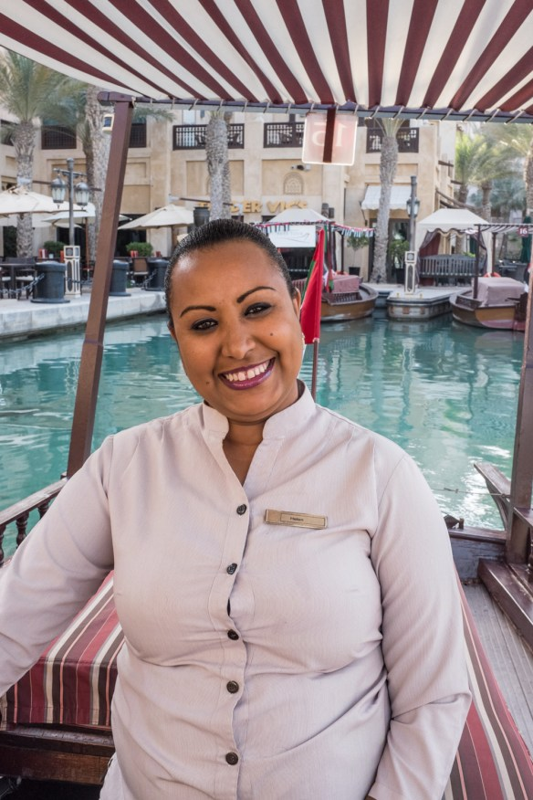 This is Captain Helen, from Ethiopia. She drives an abra launch at the Madinat Jumeirah hotel. Helen is an example of people from around the world who have come to Dubai to work.