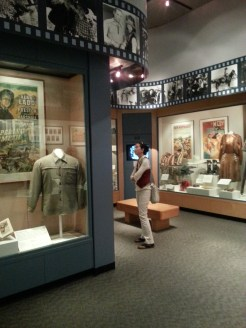 Dr. Jennifer Smith observing a costume display at the Gene Autry Museum. Photograph by Rosemary Irvine