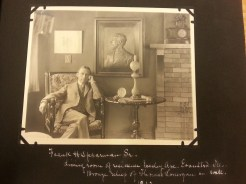 MSMC archive photograph of Frank H. Spearman in his home in Illinois (1912) bronze relief of Thomas Lonergan in the backgroun (father to Eugenie Spearman). Photograph by Rosemary Irvine