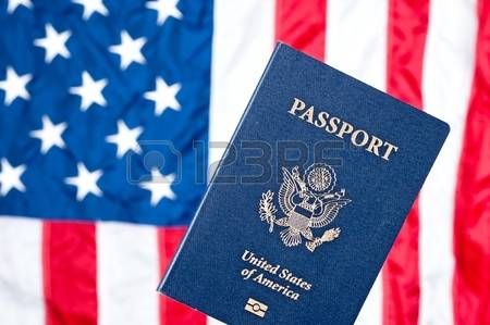 11199757-a-passport-with-the-american-flag-in-the-background.jpg