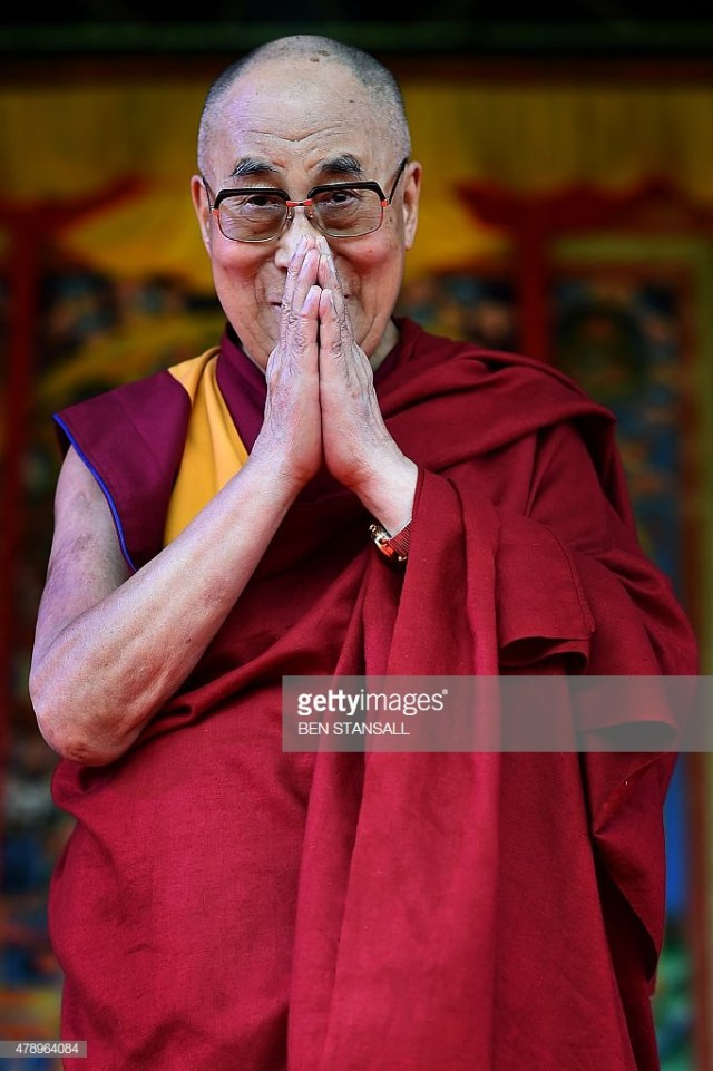 the-dalai-lama-takes-to-the-stage-to-address-the-faithful-in-on-june-picture-id478964084.jpg