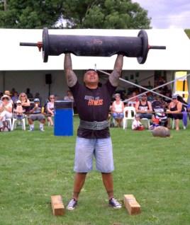 Afa Paea rises over 100kg over his head.