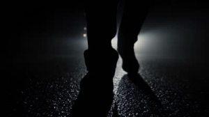 stock-footage-criminal-walking-in-dark-night-feet-walking-close-up-silhouette-shadow-background-mystical-mood