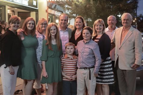 Business Legacy Award recipient Ralph Drury (right) with his family outside the Franklin Theatre.