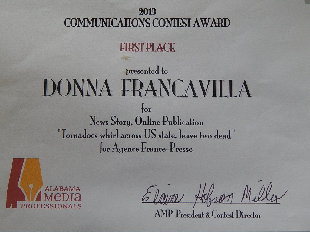 """2013 Alabama Media Professionals Communications Contest Award - State Award - First Place presented to Donna Francavilla for News Story - Online Publication """"Tornadoes whirl across US state, leave two dead"""" for Agence France-Presse"""