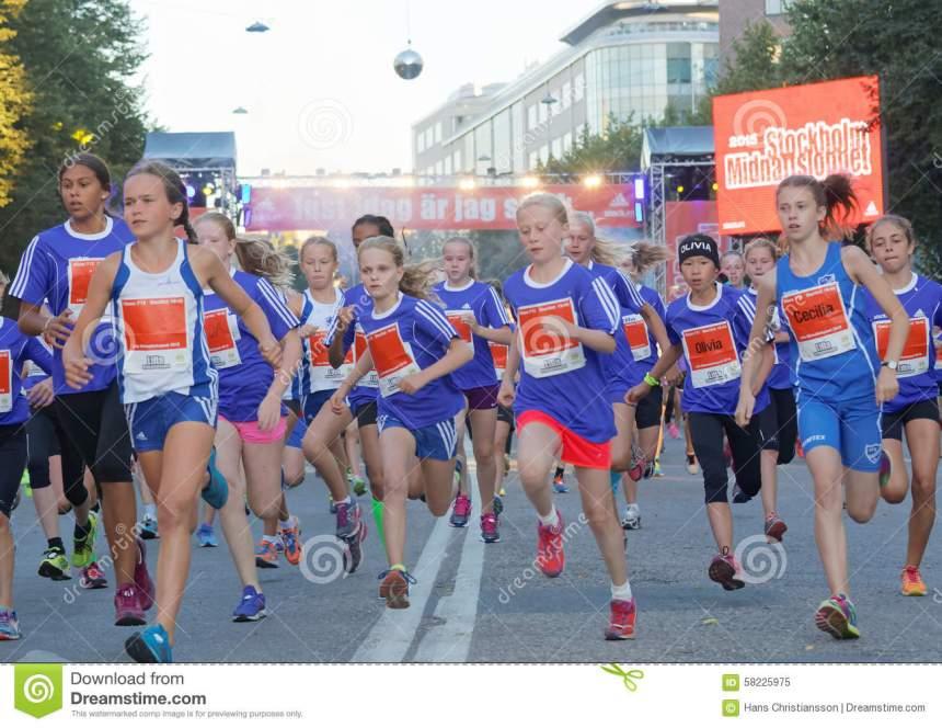 group-running-girls-blue-dresses-stockholm-sweden-aug-year-old-event-midnattsloppet-august-stockholm-58225975