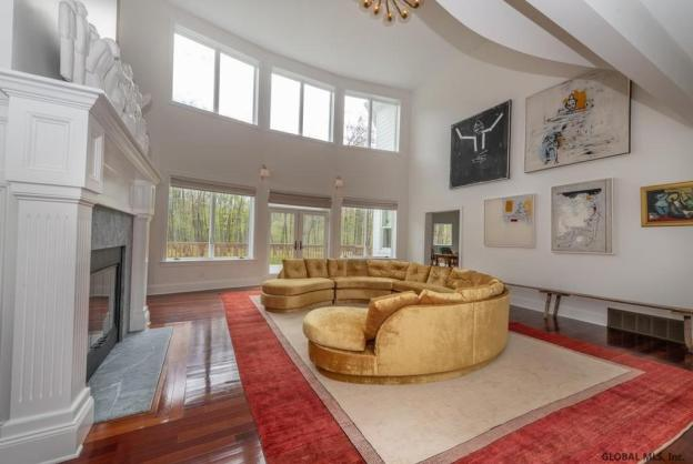 Sara Bronfman living room gold circle couch