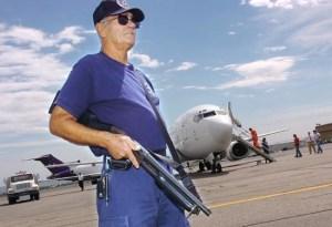 Air Safety Officer Guards Federal Prisoner Transport