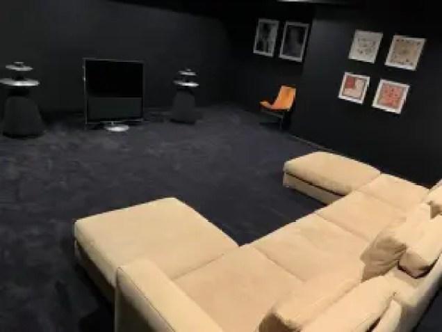 Sara Bronfman media room black carpet black walls