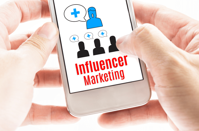 Person holding cell phone reading influencer marketing flowchart