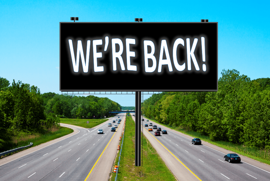 billboard on highway that reads we're back to describe return to billboard advertising