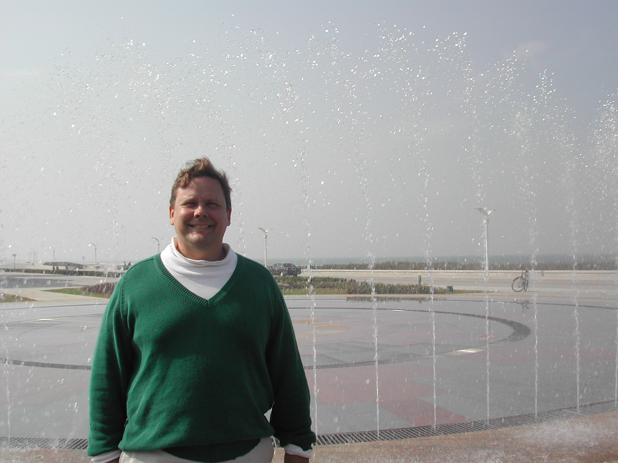 Me in front of a foutain at the seaside Yantai Targeted Economic Development Zone