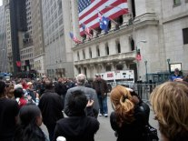 A crowd gathers as Michael Moore searches for answers at the New York Stock Exchange. Moore's new film, Capitalism: A Love Story, will be in theaters nationally on October 2nd. Released by Overture Films.