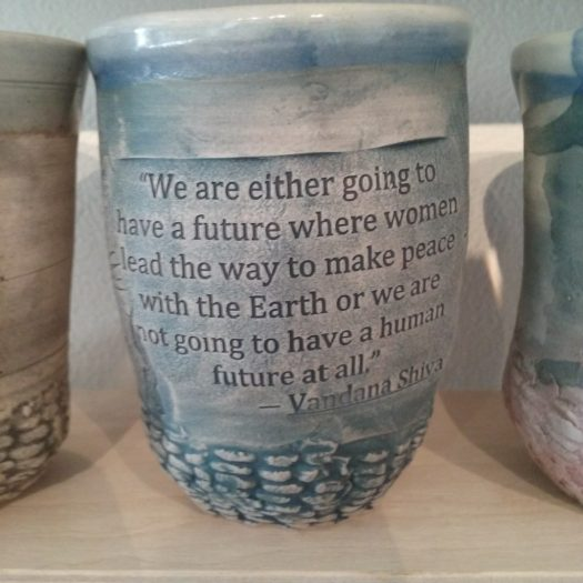 Matt cup with text impressed in We are either going to have a future where women lead the way to make peace with the earth or we are not going to have a future at all.""