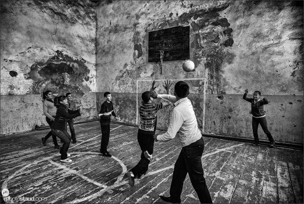 Playing basketball in a derelict sport hall in Armenia