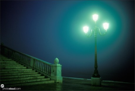 Venice in night Streetlamp on pier in rain and fog, Italy
