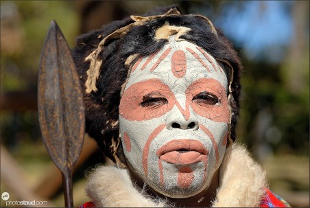 Traditional Kikuyu dancer with spear and headdress made of Colobus Monkey skin, Kenya