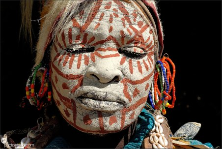 Portrait of Kikuyu tribeswoman with traditionally painted face and jewelry, Kenya
