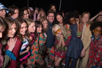 Models hugging Henry Holland backstage at House of Holland