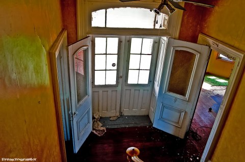abandoned house french doors