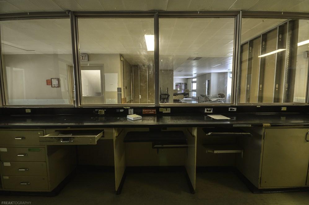 The nurses station inside a vacant psychiatric hospital