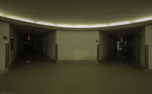 Inside the basement levels of a vacant psychiatric hospital where there are 6 options to choose from for various wings.