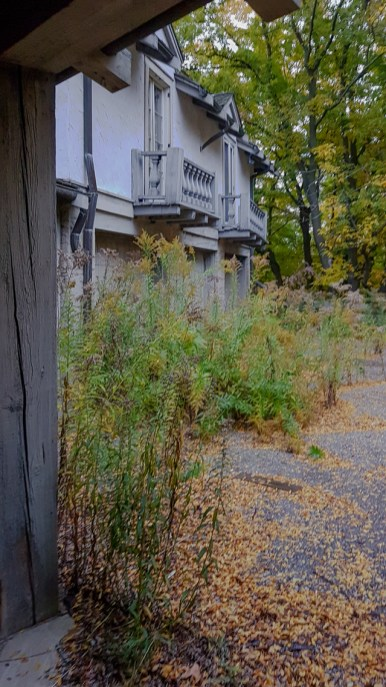 The exterior of a large abandoned ontario mansion, tucked away and hidden deep in a wooded area in Ontario
