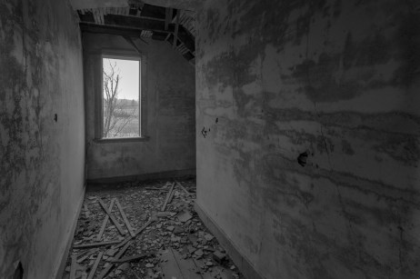 Freaktography, Ontario Abandoned, Ontario Urban Exploring, abandoned, abandoned ontario, abandoned photography, abandoned places, black and white, creepy, decay, decayed hallway, derelict, haunted, haunted places, mono, monochrome, ontario urban exploration, photography, urban exploration, urban exploration photography, urban explorer, urban exploring, wall, window
