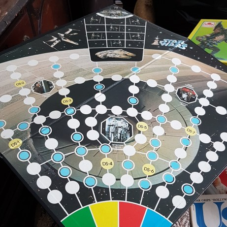 Escape from the Death Star (1977) Escape from the Death Star was one of the earliest bits of Star Wars merchandising released by Kenner (October 1977). In this game, the heroes need to escape from the Death Star's trash compactor and reach the Rebel base on Yavin 4. The board is pretty cool, featuring photos from the movie, and it has a lot of spaces for the tokens. It's a quick game with a spinning wheel and cards that give the players certain benefits and penalties.