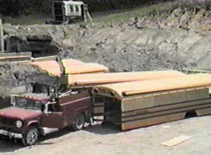 Construction of the Ark Two Nuclear Shelter made of 42 buried school busses