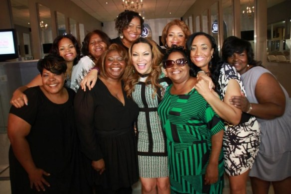 Egypt-Sherrod-poses-with-ten-lovely-moms-at-the-4th-Annual-Egypt-Mommy-Makeovers-in-Atlanta