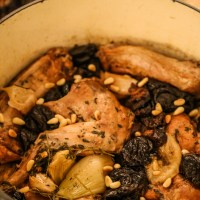 Rabbit stewed in riesling with prunes and pine nuts