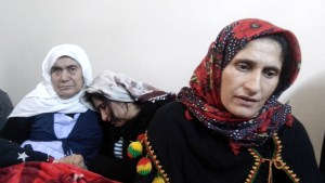 Ayse Kazanhan, mother of Nihat Kazanhan, a day after her son's death. On the left Nihat's grandmother and his sister.