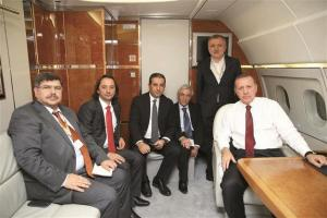 Akif Beki with Erogan in the presidential plane. He is the third from the left.