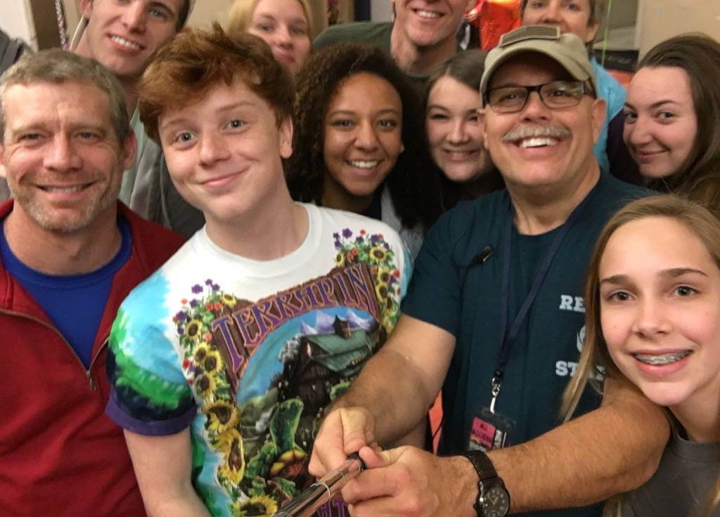 Fred Grooms with Teens