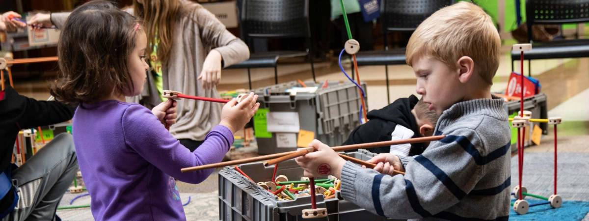 Children playing with Tinkertoys