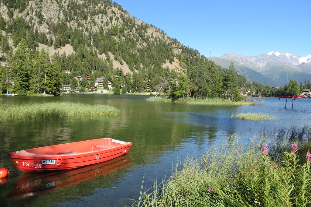 Red boat on Champex lake