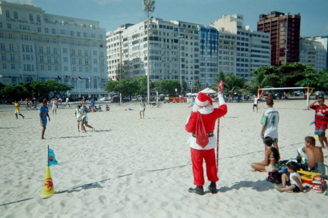Father Christmas watching a game on Copacabana beach