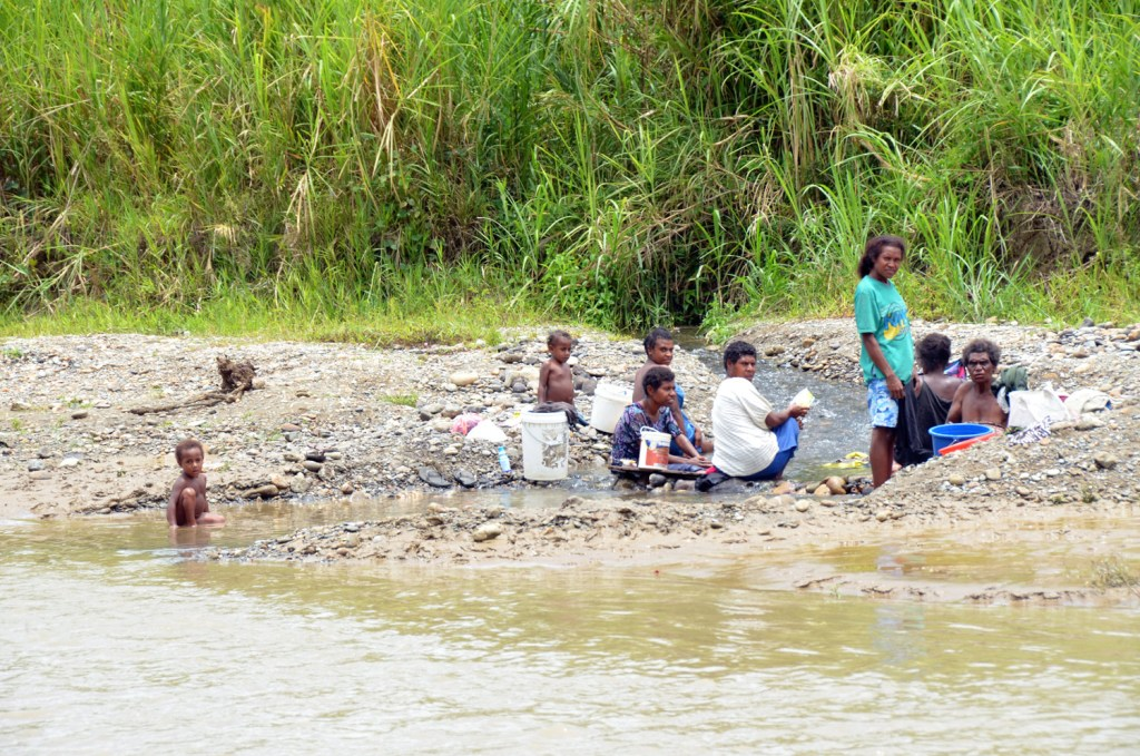 Family at the river in Papua New Guinea